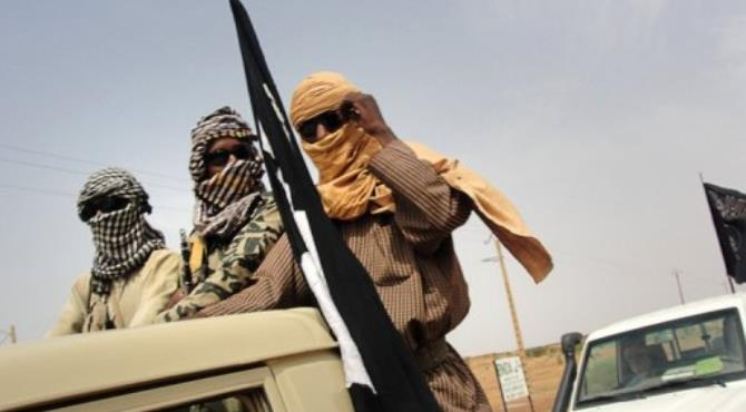 A fighter of Islamic group of MUJAO stands guard near the Gao airport.  By Romaric Ollo Hien (AFP/File)