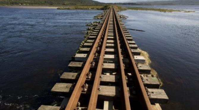 File picture shows a section of railway line at Swartvlei Lagoon close to Knysna, South Africa.  By Rodger Bosch (AFP/File)