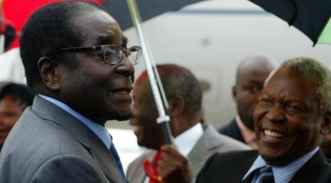 Robert Mugabe appeared healthy as he walked off his charter plane in Harare.  By Jekesai Njikizana (AFP)