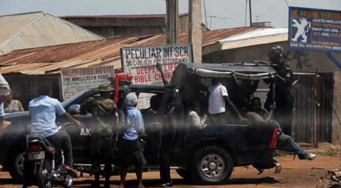 People are escorted out of Kaduna on June 19 after the riots sparked by religious violence.  By Victor Ulasi (AFP/File)