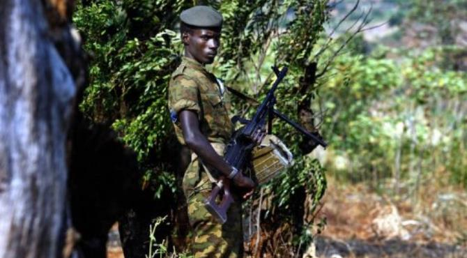 A Burundian soldier patrols the perimeter of the southern district of Musaga in Bujumbura.  By Marco Longari (AFP/File)