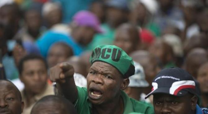 AMCU (Association of Mineworkers and Construction Union) members march in Johannesburg on March 27, 2014.  By Mujahid Safodien (AFP/File)