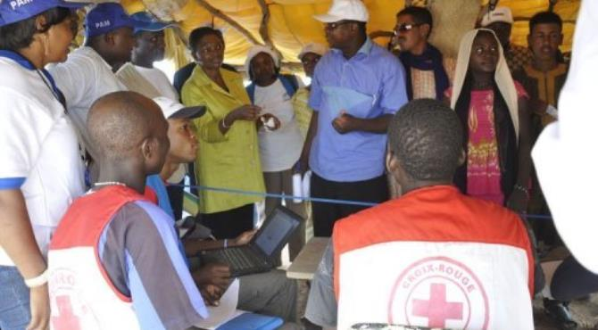 Valerie Amos (4th L), the United Nations aid chief, talks with Red Cross and other humanitarian workers.  By Ahmed Ouoba (AFP/File)