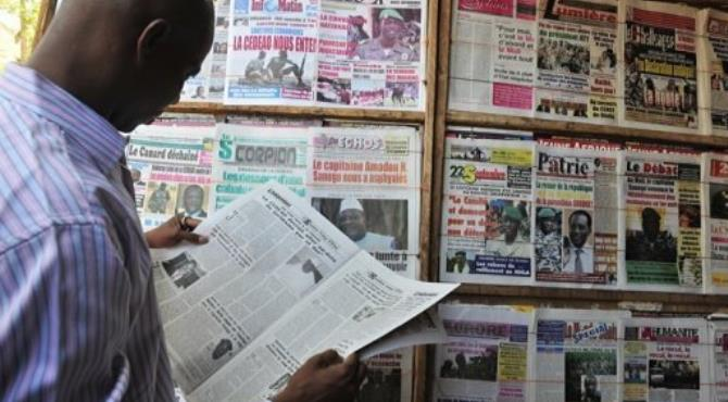 A man reads a local newspaper on April 4, in Bamako.  By Issouf Sanogo (AFP/File)