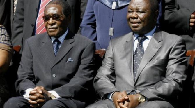Tsvangirai (right) and Mugabe formed a coalition government in February 2009.  By Desmond Kwande (AFP)