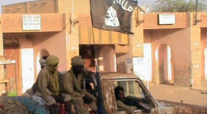 TV grab shows a pick up truck carrying supporters of the Islamist group Ansar Dine, on April 3, in Timbuktu.  By  (AFP/France 2)