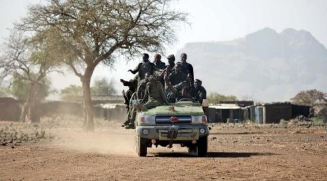 Members of the Sudanese Army atop of a four-wheel drive in Jawa village in 2011.  By Albert Gonzalez Farran (AFP/UNAMID/File)