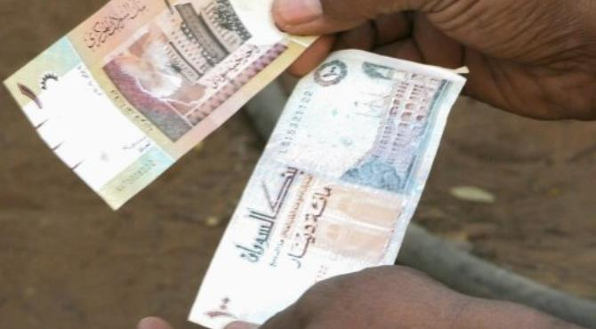 Sudan's beleaguered currency has gained eight percent on the black market.  By Isam Al-Haj (AFP/File)