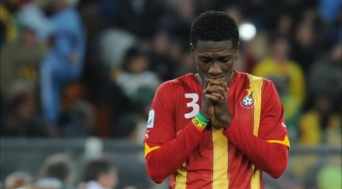 Distraught Asamoah Gyan after he missed the penalty shot against Uruguay
