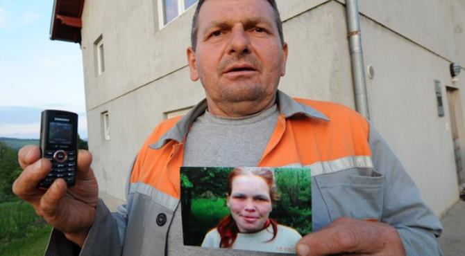 AFP/Getty Neighbour Sead Makalic poses with his cellphone and a picture of the German girl
