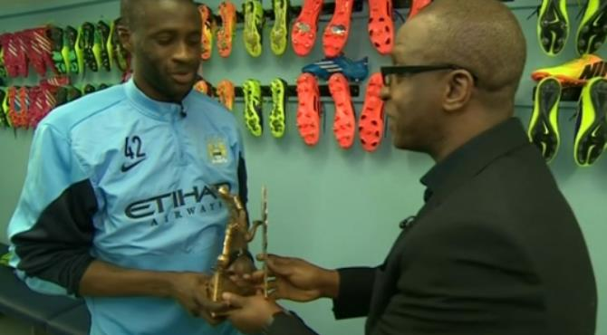 Yaya Toure being presented with the award on Monday