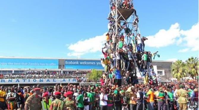 Many Zambians have taken an impromptu day off work to welcome the team