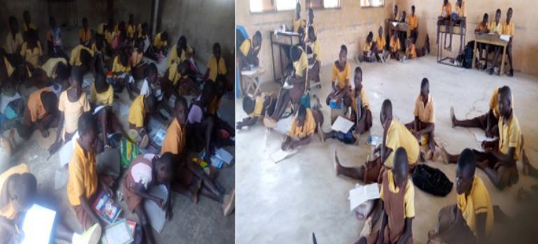 Pupils sitting on bare floor during lesson period at Nayorigo Primary School