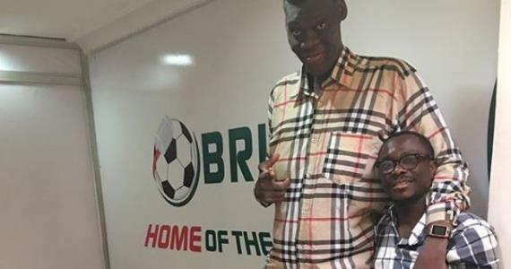 Comedian, Julius Agwu Meets with Tallest Man at Brilla FM