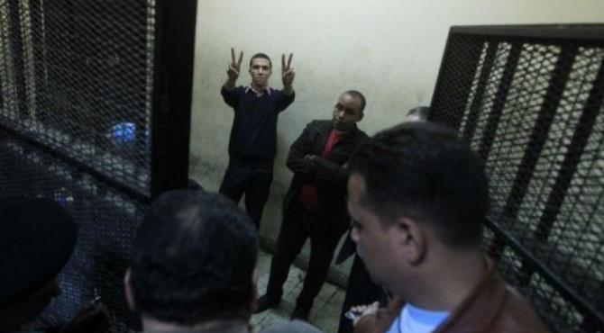 Some of the fourteen Egyptian activists are seen during their trial on February 26.  By Khaled Desouki (AFP/File)