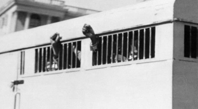 Eight men, among them Nelson Mandela, sentenced to life imprisonment, leave the Palace of Justice in 1964.  By  (AFP/File)