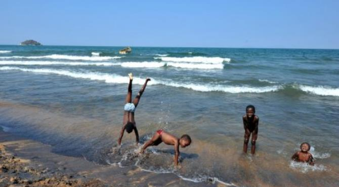 Children play along the Saga beach, at Lake Malawi, in 2011.  By Alexander Joe (AFP/File)