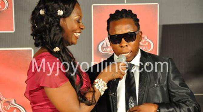 Confidence interviewing Edem on the red carpet