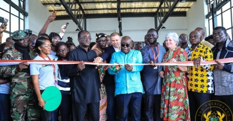 President Akufo-Addo cutting the tape for the commissioning of the second medical drone delivery facility