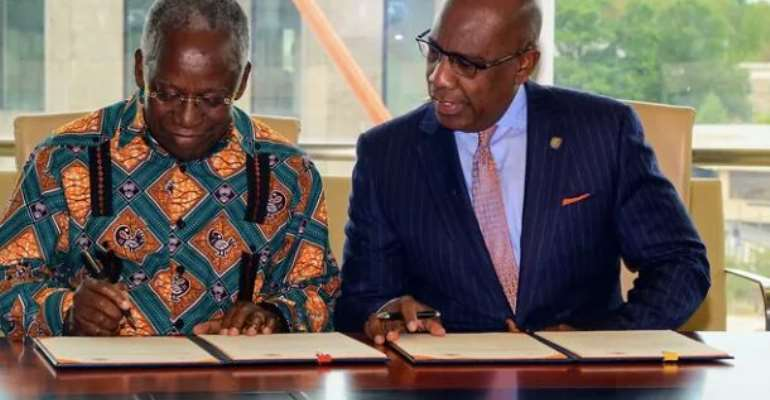 Mr.  Yankah ,left and Dr.  Wilson, right initiating the MOU on behalf of their respective outfits.