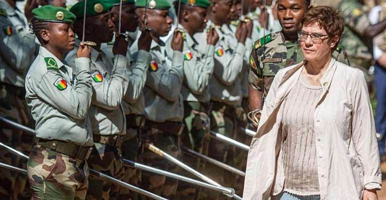 German Defence Minister Kramp-Karrenbauer is received with military honours at the Mali Armed Forces Training Centre in the town Koulikoro