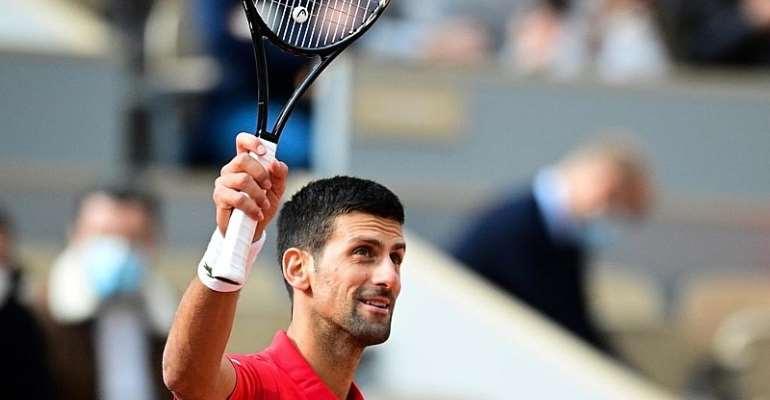 Djokovic crushes Berankis to waltz into third round at French Open