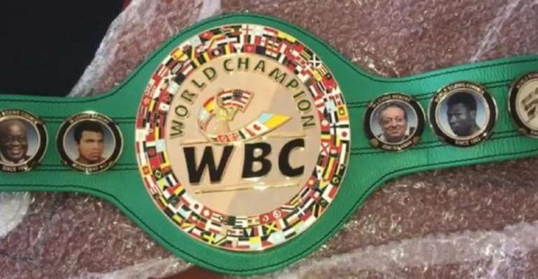 WBC Awards DK Poison A New Belt With Akufo-Addo Image Embossed