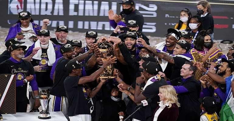 The Los Angeles Lakers celebrate after defeating the Miami Heat 106-93 in Game 6 of the NBA Finals, winning the franchise's 17th title.