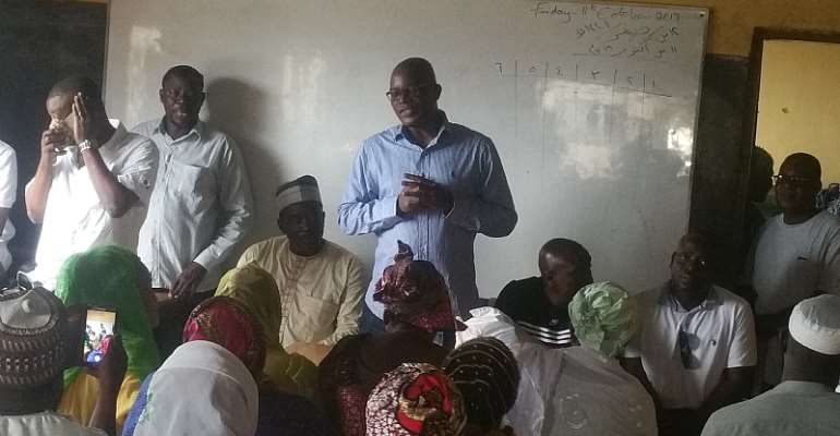Hon. Nasser Toure ( in blue shirt)addressing the gathering with Dr.  Azindow ( 3rd from left)