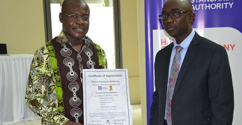 Prof. Dodoo, GSA Director-General (Left) and Dr Akwasi Achampong, GSA Board Chairman after receiving a certificate of accreditation from Daaks, A German Accreditation Agency