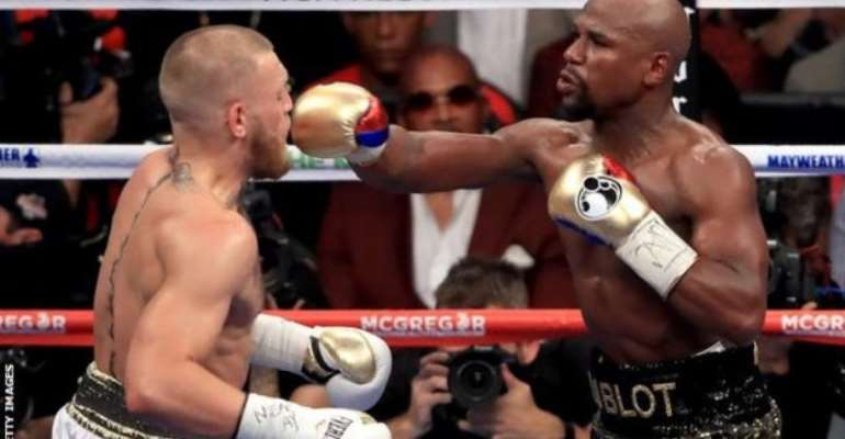 Mayweather (right) and McGregor met in on the richest bouts in boxing history