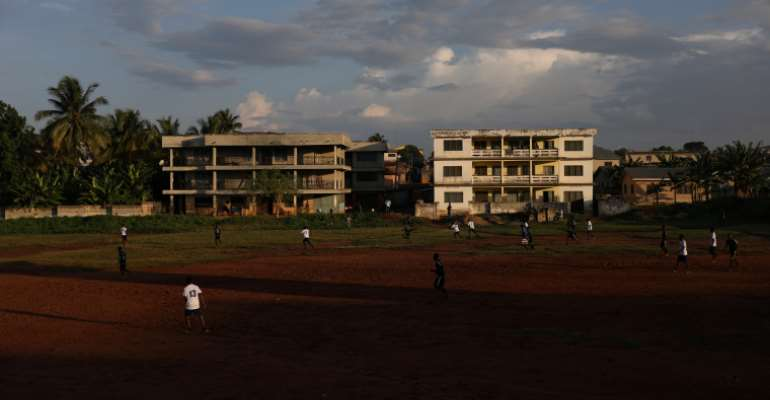 People play soccer in Mampong, a small town in the Ashanti region, Ghana, in July 2019. A journalist was charged with publishing 'false news' in October 2020 for a report on a pre-election crisis in Ashanti. (Reuters/Siphiwe Sibeko)