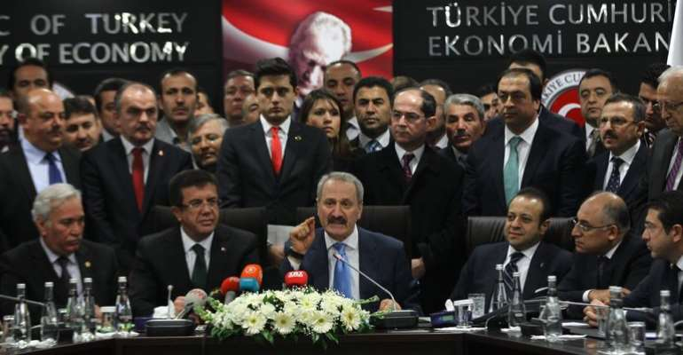 Zafer Caglayan, center above, a former Turkish economy minister, is among four Turkish citizens recently indicted by federal prosecutors in New York.