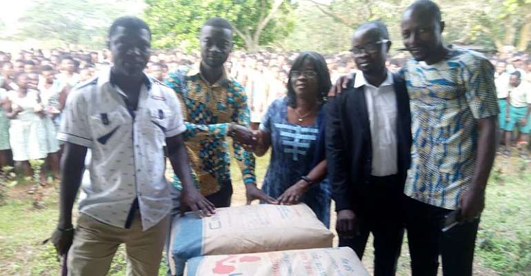 Abrefa presenting the items to the Assistant headmistress