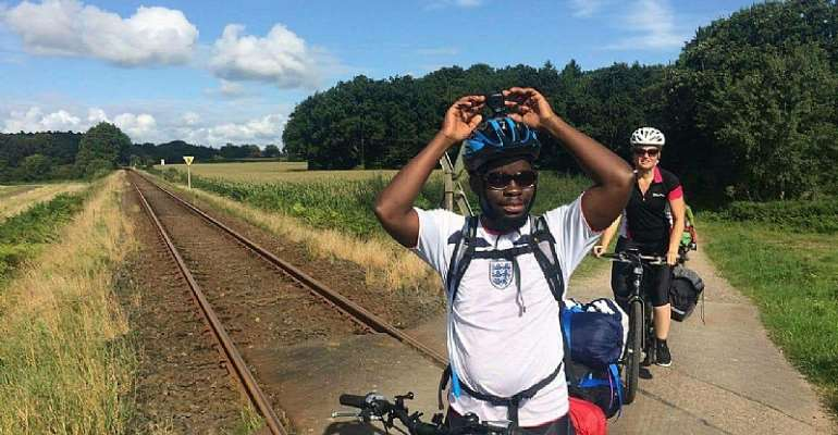 Ghanaian Cycles 19 Days from Denmark to Swansea to fight against Illegal Migration