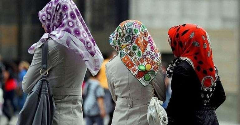 Macron warns against stigmatising Muslims as headscarf row deepens