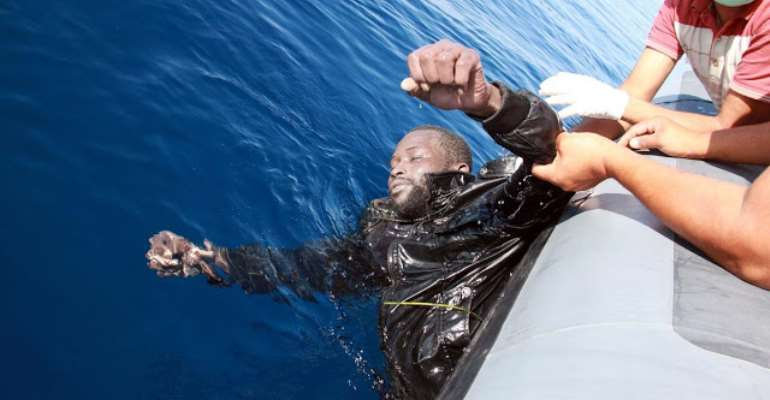 Coast guards pull a drowning man from the Mediterranean