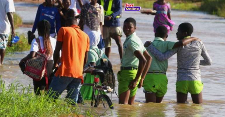 Students Walk In Floods To School At Ngleshie Amanfro [Photo]