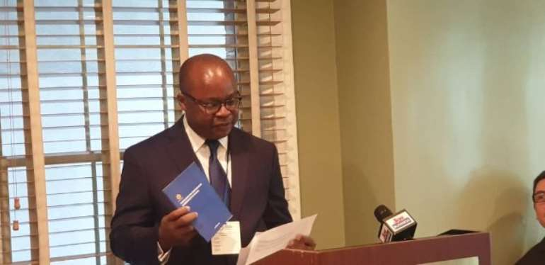 Governor of the Bank of Ghana, Dr Ernest Addison launching the guidelines on the sidelines of the IMF/World Bank Annual Meeting in Washington DC