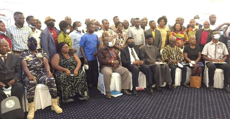 Security personnel, Chairman of the National Peace Council, Prof. Emmanuel Asante, and officials of CODEO in a group photograph after the opening ceremony.