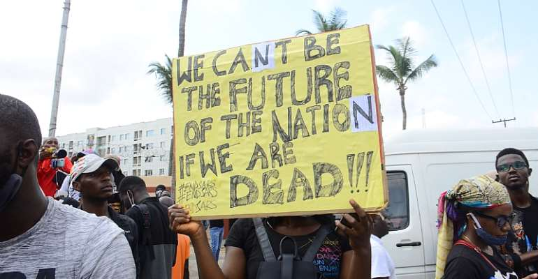 Nigerian youths protest against the police brutality. - Source: Photo by Olukayode Jaiyeola/NurPhoto via Getty Images