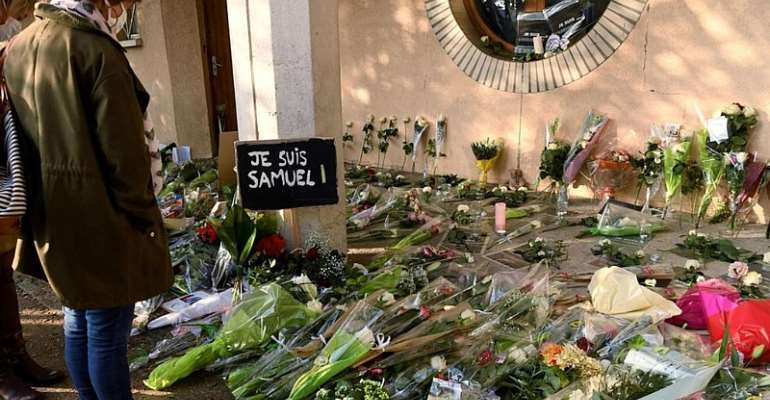 French prosecutors charge two pupils, five adults over teacher's murder