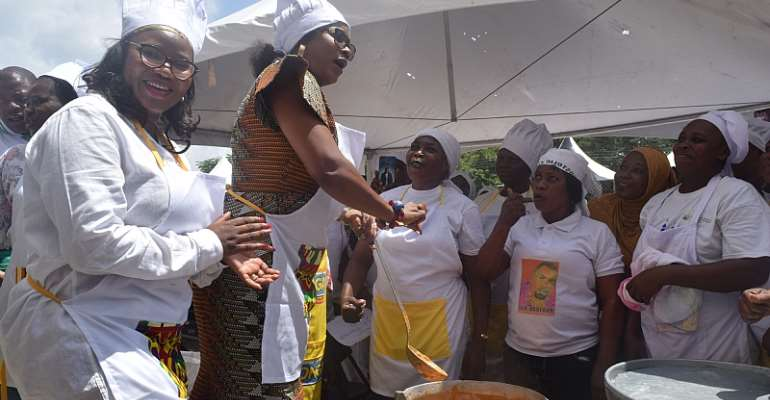 Ms. Kefilwe Moalosi, Nutrition Project Manager of the AUDA-NEPAD (left) and Mrs. Cynthia Morrison, Gender Minister leading the cooking demo