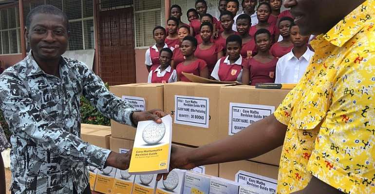 Headmaster Of Simms Senior High School Mr. Eric Adom Marfo Receiving The Books On Behalf Of The School