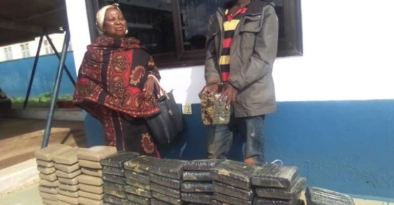 Abena Abuyaa and her accomplice Kwadwo Kinto standing behind the parcels of wee