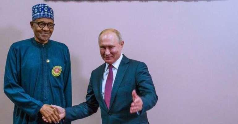 Russia President Vladimir Putin dey shake Nigerian President Muhammadu Buhari hand for di Russia-Africa summit for Sochi. (Wednesday October 23, 2019)