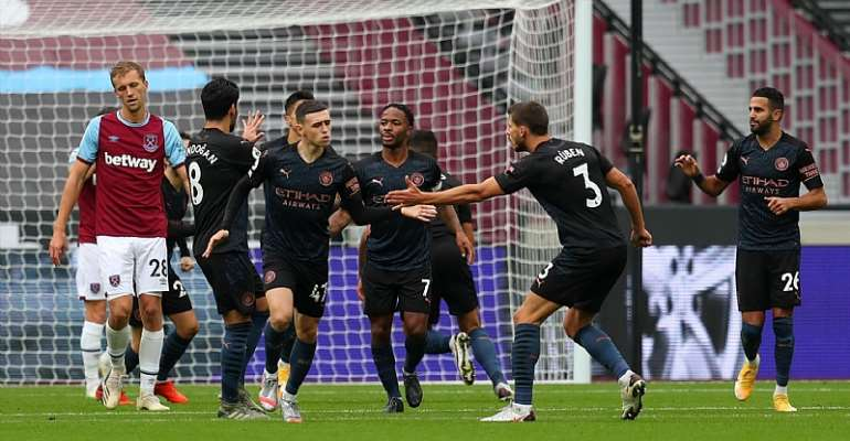 PHIL FODEN OF MANCHESTER CITY CELEBRATES WITH TEAMMATES