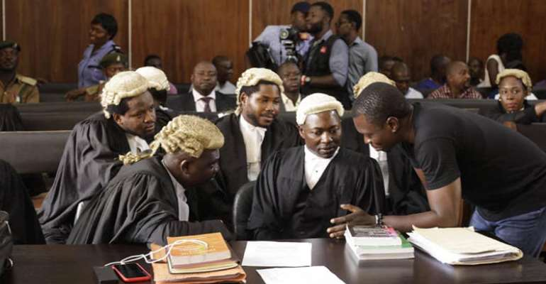 CrossRiverWatch journalist Agba Jalingo (right) is seen in a federal high court in Calabar, Nigeria. The court recently granted anonymity to witnesses expected to testify against Jalingo. (Oto-Obongo Clement/CrossRiverWatch)