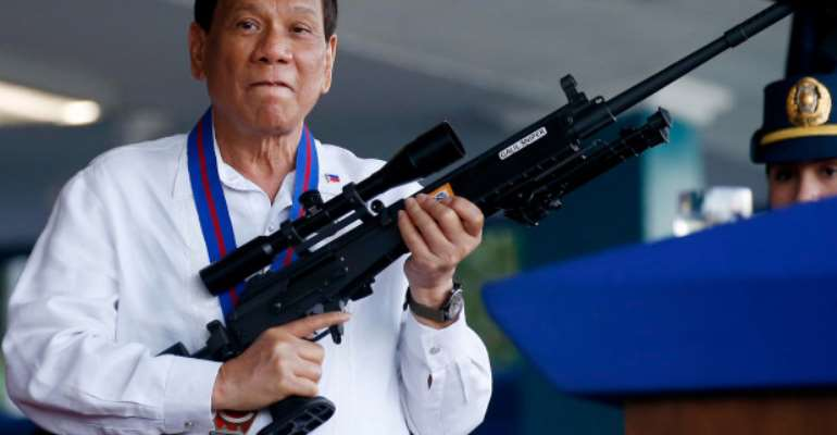 The Philippine leader wants to give the public 42,000 free guns, photo credit: AP