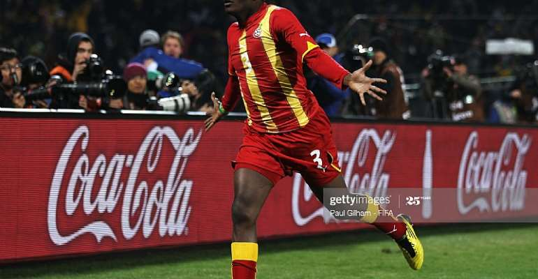 RUSTENBURG, SOUTH AFRICA - JUNE 26: Asamoah Gyan of Ghana celebrates scoring his side's second goal during the 2010 FIFA World Cup South Africa Round of Sixteen match between USA and Ghana at Royal Bafokeng Stadium on June 26, 2010 in Rustenburg, South Africa. (Photo by Paul Gilham - FIFA/FIFA via Getty Images)
